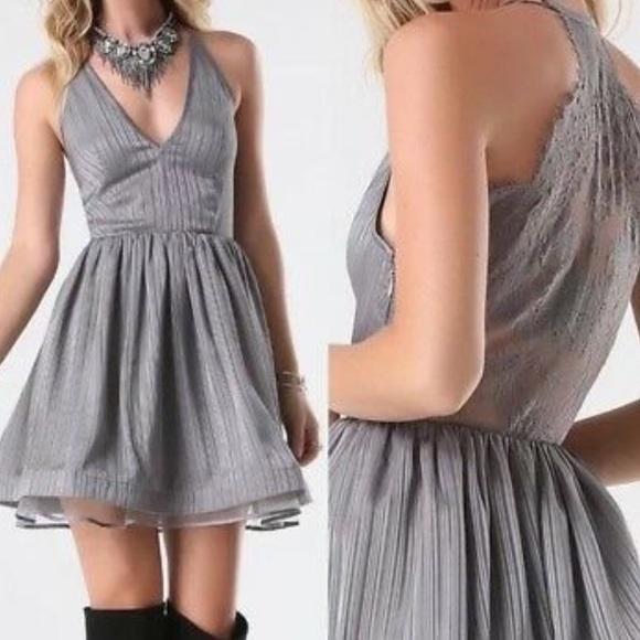 bebe Dresses & Skirts - NWT Bebe lace back metallic stripe dress